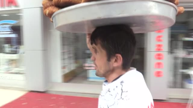 a simit seller in turkey's northwestern kocaeli province has donated his twoday earnings to rohingya muslims who are facing persecution in myanmar's... - bagel stock videos & royalty-free footage