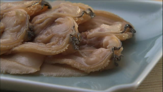 simmering clams fill a platter. - clam seafood stock videos and b-roll footage