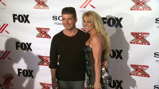 simon cowell, britney spears at the x factor viewing party sponsored by sony x headphones on in los angeles, ca. - the x factor stock videos & royalty-free footage