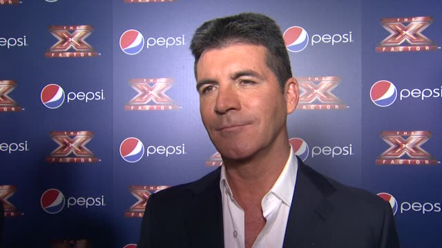 simon cowell on if he thought the top 10 would turn out this way, what happens to a judge when all of there artists are voted off, how it feels to... - judge entertainment stock videos & royalty-free footage