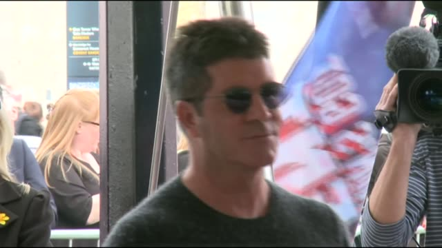 simon cowell's home burgled in west london; lib / simon cowell wearing sunglasses at photocall fro britain's got talent 2012 launch event - britain's got talent stock-videos und b-roll-filmmaterial