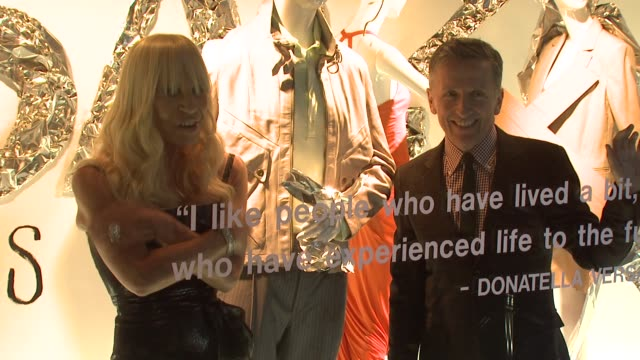 stockvideo's en b-roll-footage met simon doonan in department store window at the donatella versace launches her new line of menswear at barneys new york in new york new york on march... - versace modelabel
