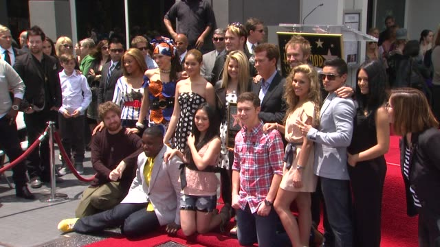 simon fuller and the american idol top 13 contestants at the simon fuller honored with star on the hollywood walk of fame at hollywood ca - american idol stock videos and b-roll footage