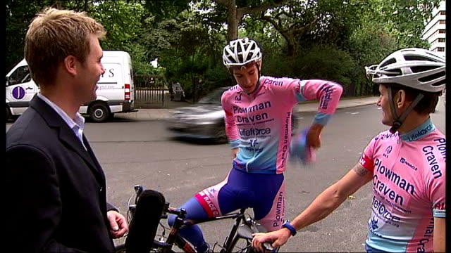 simon gaywood and simon richardson interviewed sot reporter along into telephone box and out again wearing lycra cycling kit sot reporter and cyclist... - tour of britain stock videos & royalty-free footage