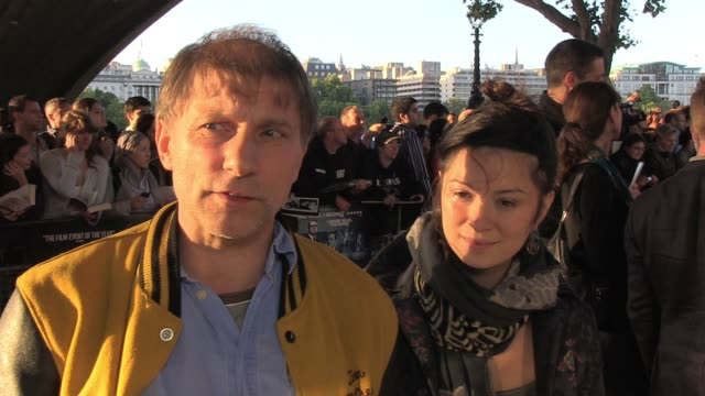 simon mcburney talks of his love of john le carre books and also how well the movie stays true to the novel and yet grows on it. interview: simon... - デビッド コーンウェル点の映像素材/bロール
