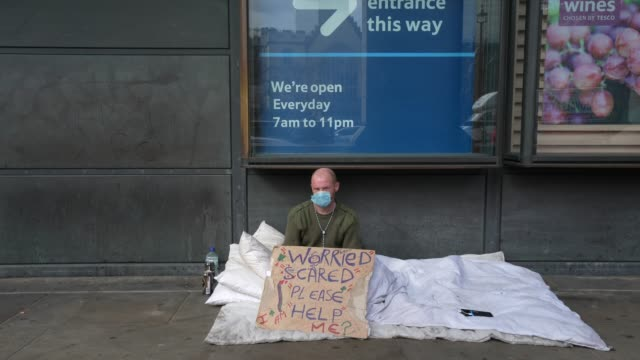 simon patterson, a homeless man living around westminster sits on an empty street on march 31, 2020 in london, england. like many other countries... - homelessness stock videos & royalty-free footage