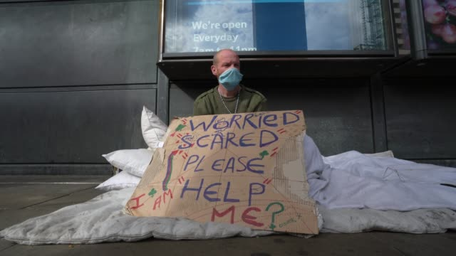 simon patterson a homeless man living around westminster sits on an empty street on march 31 2020 in london england like many other countries around... - homelessness stock videos & royalty-free footage
