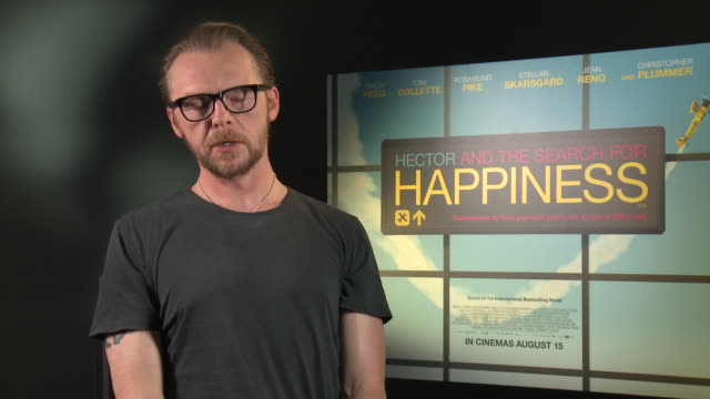 INTERVIEW Simon Pegg on being unhappy his reflections on it his midlife crisis at 'Hector and the Search for Happiness' Interview on August 12 2014...