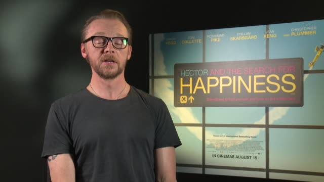 INTERVIEW Simon Pegg on who is better at dancing him or Nick Frost at 'Hector and the Search for Happiness' Interview on August 12 2014 in London...