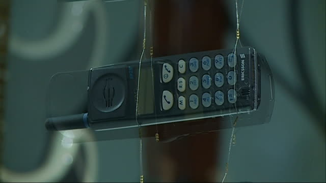 simon to feature in new 'information age' exhibition at science museum; london: science museum: int close shots of old mobile phones on display - new age stock videos & royalty-free footage