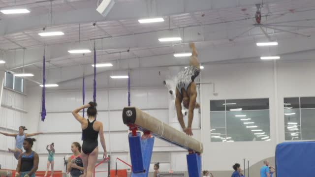 simone biles training at a gymnastics camp in texas - gymnastics stock videos & royalty-free footage