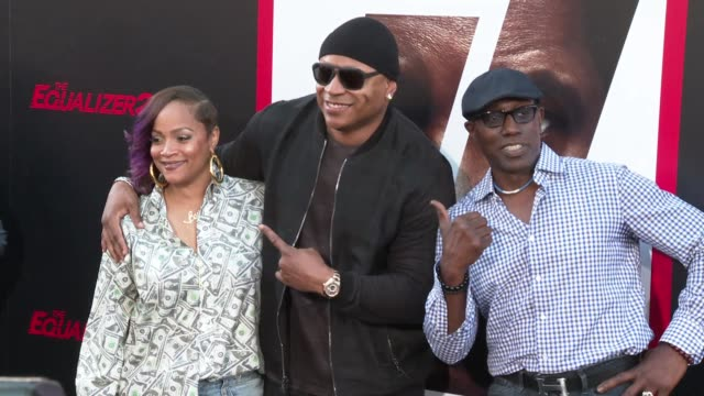 Simone Johnson LL Cool J and Wesley Snipes at the 'The Equalizer 2' Premiere at TCL Chinese Theatre on July 17 2018 in Hollywood California