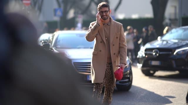 Simone Marchetti wearing beige wool coat pants with leo print is seen during Milan Menswear Fashion week Fall/Winter 2018/19 on January 13 2018 in...