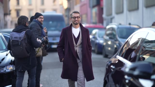 simone marchetti wears glasses a white tshirt a gray checked blazer jacket suit pants black leather shoes a purple coat outside marni during milan... - marni stock videos & royalty-free footage