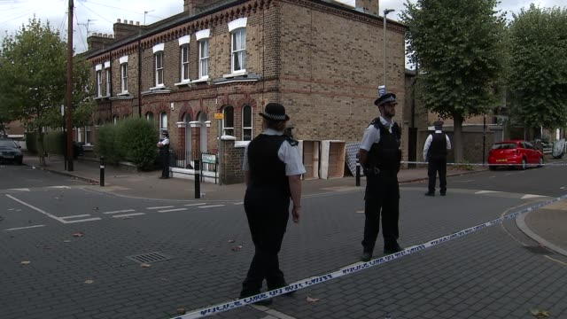 Boyfriend appears in court via videolink 1682018 ENGLAND London Battersea EXT Police officers and police tape cordons in street Forensic officer...