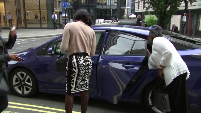 jury hears 999 call confession; england: london: the old bailey : ext amoy johnson and sally anne miller getting out of car reporter to camera - confession law stock videos & royalty-free footage