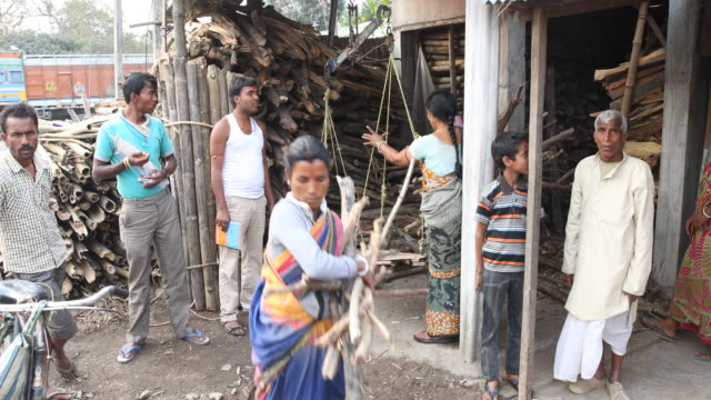 simple wood selling business in the mountains near darjeeling - dhoti video stock e b–roll