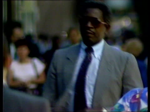 former role model; people to & fro in street cms ditto pull focus cms vox pops sot - o.j. simpson stock videos & royalty-free footage