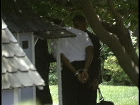 simpson in handcuffs speaking to law enforcement at his home - handcuffs stock videos & royalty-free footage
