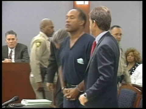 oj simpson on trial on kidnapping and armed robbery charges via nevada las vegas j simpson into courtroom on trial on kidnapping and armed robbery... - legal trial stock videos & royalty-free footage