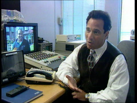 simpson visit to britain; cms harvey levine watching tape of simpson cms ditto cms harvey levine intvwd sot -simpson's visit to england is to use it... - o.j. simpson stock videos & royalty-free footage
