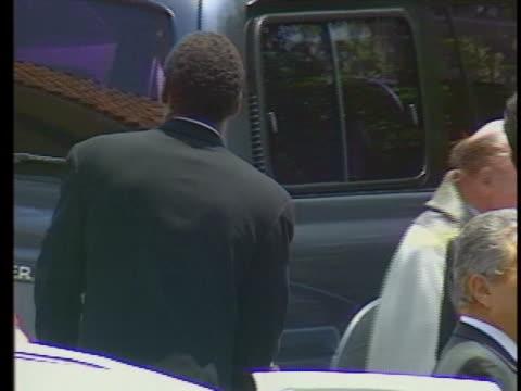 simpson walking with kids at nicole brown simpsons funeral - orange juice stock videos & royalty-free footage
