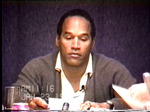 OJ Simpson's civil trial deposition 1114 AM 1/23/96 OJ questioned about and identifying clothing from photos