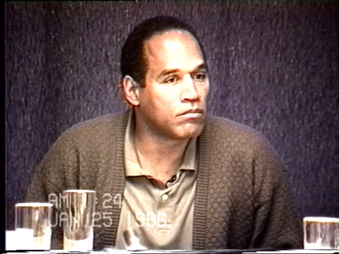 OJ Simpson's civil trial deposition 1122AM 1/25/96 OJ is questioned about abusing Nicole and is presented with photos of Nicole's injuries