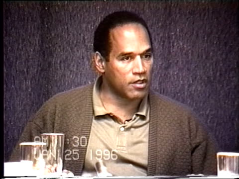 OJ Simpson's civil trial deposition 1129AM 1/25/96 OJ is questioned about abusing Nicole and is presented with photos of Nicole's injuries