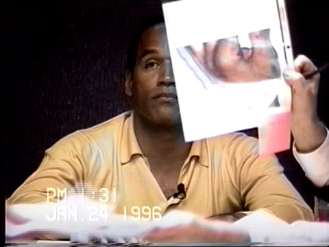 simpson's civil trial deposition 1:30pm 1/24/96 - questions referring to photos of o.j.'s cuts taken during dr. huizenga's examinations - o・j・シンプソン点の映像素材/bロール