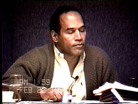 simpson's civil trial deposition 1:57pm 2/22/96 - questions about if nicole was afraid of o.j. including the 1993 911 call and nicole's diaries - o・j・シンプソン点の映像素材/bロール