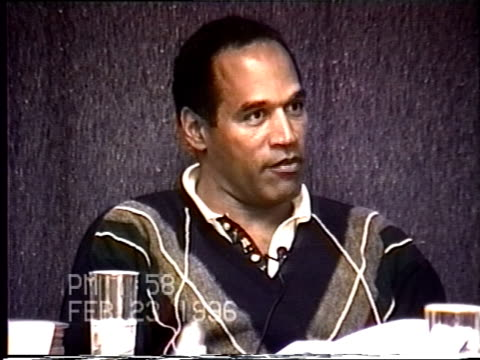 oj simpson's civil trial deposition 158pm 2/23/96 questions about nicole's breast implants and who's idea it was to get them - brustimplantat stock-videos und b-roll-filmmaterial