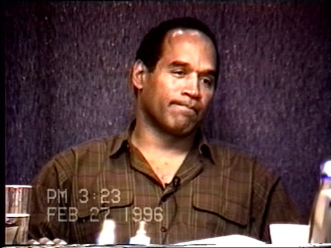 simpson's civil trial deposition 3:21pm 2/27/96 - questions about o.j.'s actions on the 5 days directly following the murders - seguire attività che richiede movimento video stock e b–roll