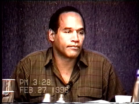 simpson's civil trial deposition 3:27pm 2/27/96 - questions about o.j.'s actions on the 5 days directly following the murders - seguire attività che richiede movimento video stock e b–roll