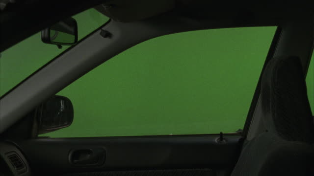 a simulation depicts the passenger side of an automobile interior prior to a storm simulation. - car chroma key stock videos & royalty-free footage