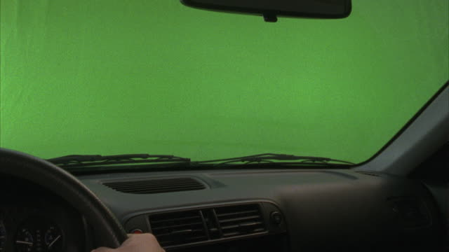 a simulation recreates an automobile interior as the vehicle is driven prior to storm conditions. - car chroma key stock videos & royalty-free footage