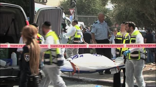 stockvideo's en b-roll-footage met simultaneous attacks in jerusalem have left three people dead and more than 20 injured including israelis and two palestinian suspects in armon... - oost jeruzalem
