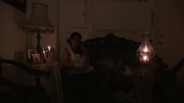 since a massive and crippling power outage knocked out electricity in venezuela many families are struggling to survive amid the lingering blockout... - fuel and power generation stock-videos und b-roll-filmmaterial