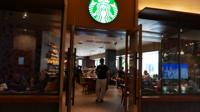 since june 1st 2017 the fulltime employees of starbucks in chinese market who have worked for two years and have parents younger than 75 years old... - city break stock videos & royalty-free footage