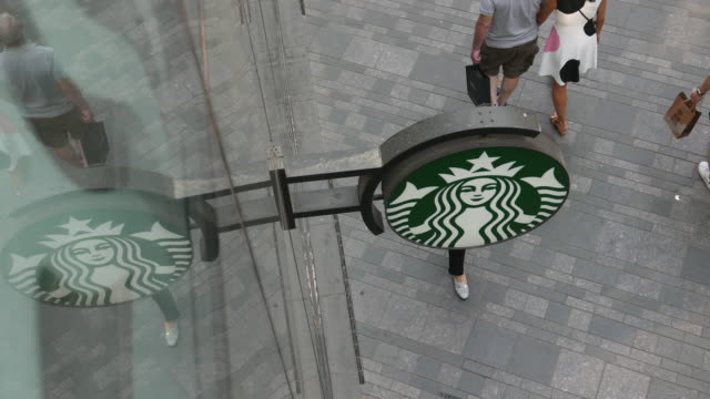 vídeos de stock, filmes e b-roll de since june 1st 2017 the fulltime employees of starbucks in chinese market who have worked for two years and have parents younger than 75 years old... - starbucks