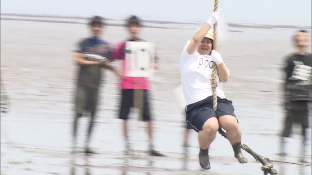 since the tideland of ariake sea has the largest tidal variation in japan gatalympics is an event held in this mudflats of the ariake sea kashima... - ariake sea stock videos and b-roll footage