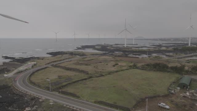 sinchang windmill coastal road in jeju island, south korea - turbine stock videos & royalty-free footage