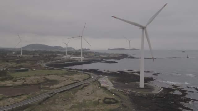 sinchang windmill coastal road in jeju island, south korea - mill stock videos & royalty-free footage