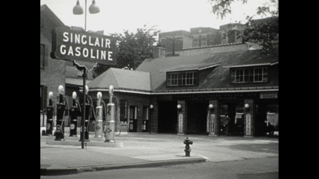 1930 sinclair gas station and greasing palaces exteriors - gas station attendant stock videos and b-roll footage