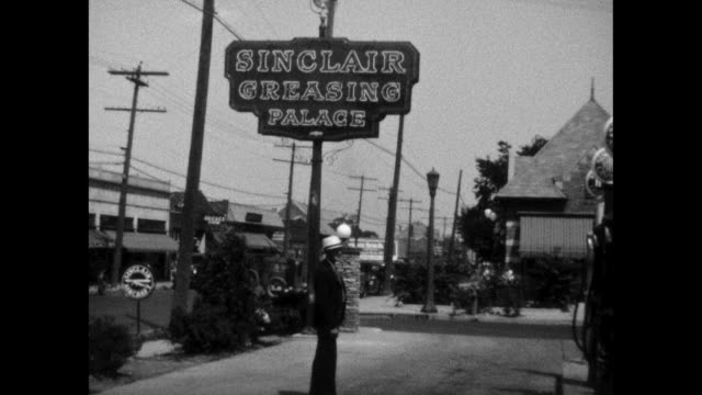 1930 sinclair gas station scenes - gas station attendant stock videos and b-roll footage