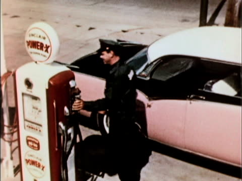 sinclair service station attendant encourages customer to pull forward car pulls forward a few feet attendant lifts pump nozzle and starts to fill up... - gas station attendant stock videos and b-roll footage