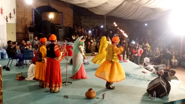 sindhi folk dancers performing in their traditional costumes and ornaments - ライブイベント点の映像素材/bロール