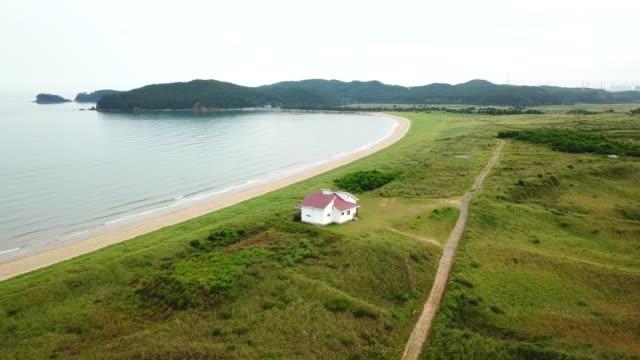 vídeos y material grabado en eventos de stock de sinduri beach in sindu-ri coastal sand dune (korea natural monument no. 431) / taean-gun, chungcheongnam-do, south korea - erial