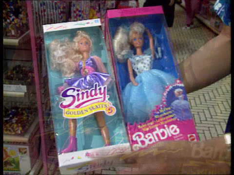sindy v barbie barbie dolls in boxes sindy barbie dolls held side by side sindy display - side by side stock videos & royalty-free footage