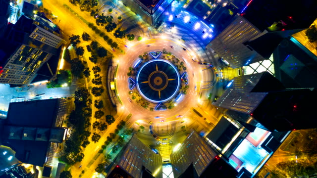 singapore aerial panorama view at night time-lapse at fountain of wealth roundabout - singapore stock videos & royalty-free footage